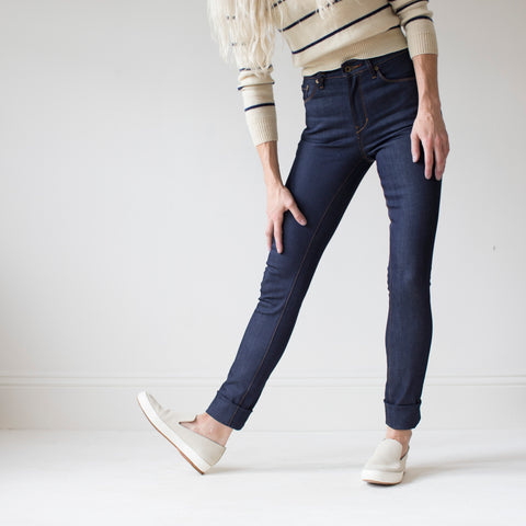 angle: indigo | A model wears Raleigh Denim Workshop Haywood high-rise skinny jeans in dark blue, front view