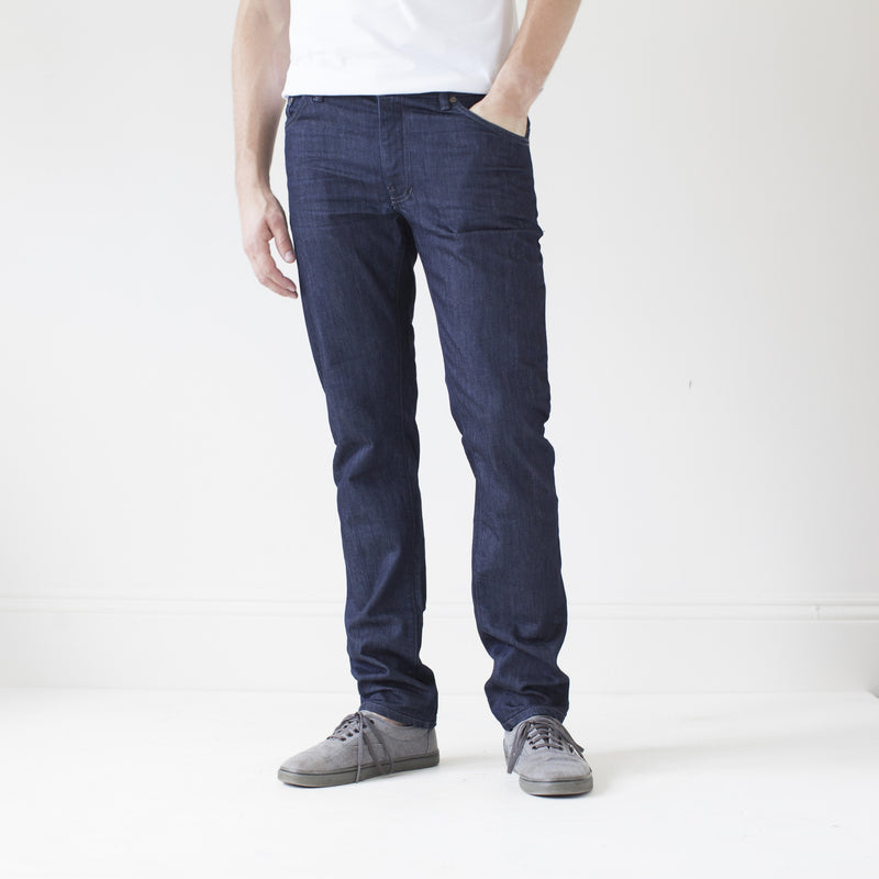 angle hover: resin rinse  A model wears Raleigh Denim Workshop Jones thin fit in a dark wash, front view