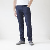 angle: resin rinse  A model wears Raleigh Denim Workshop Jones thin fit in a dark wash, front view
