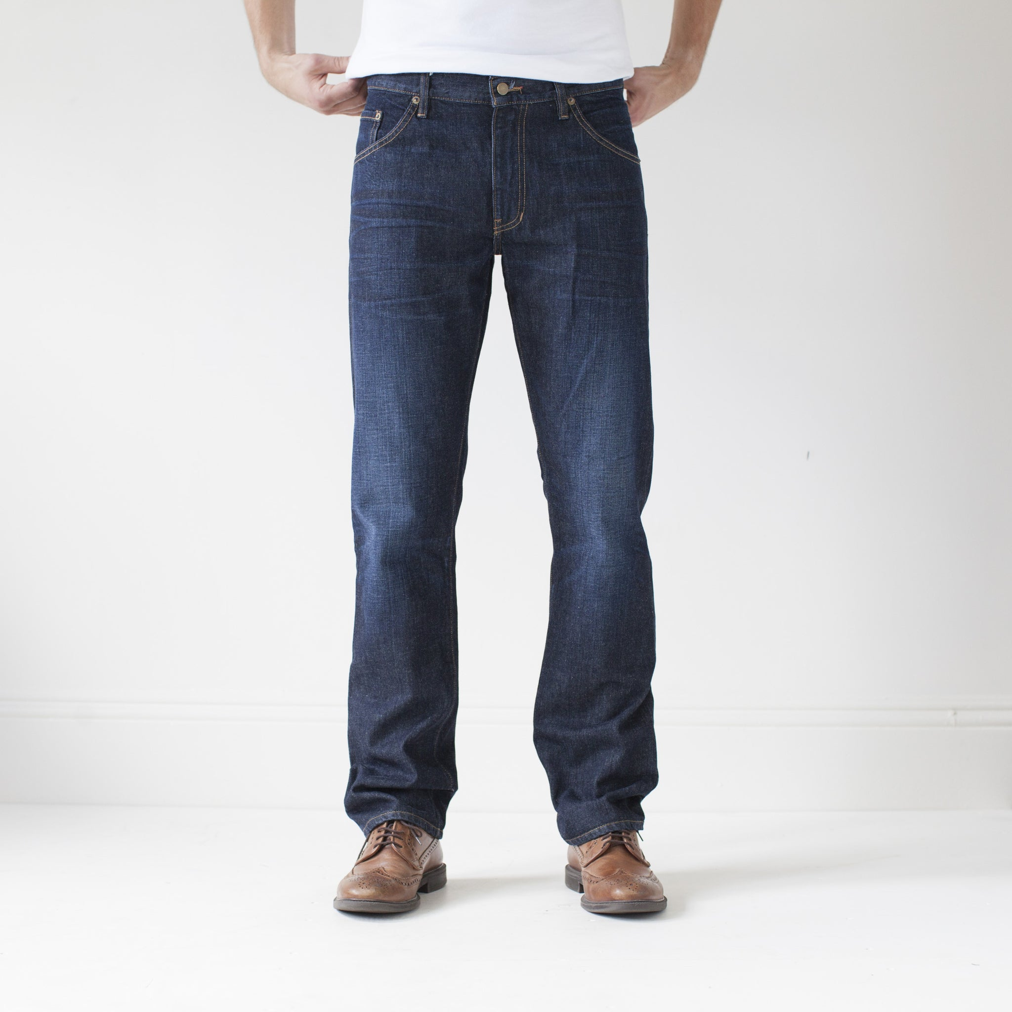 angle hover: general  A model wears Raleigh Denim Workshop Jones thin fit in a general wash, front view