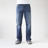 angle: 319 Wash  A model wears Raleigh Denim Workshop Alexander work fit jeans in the 319 wash, front view