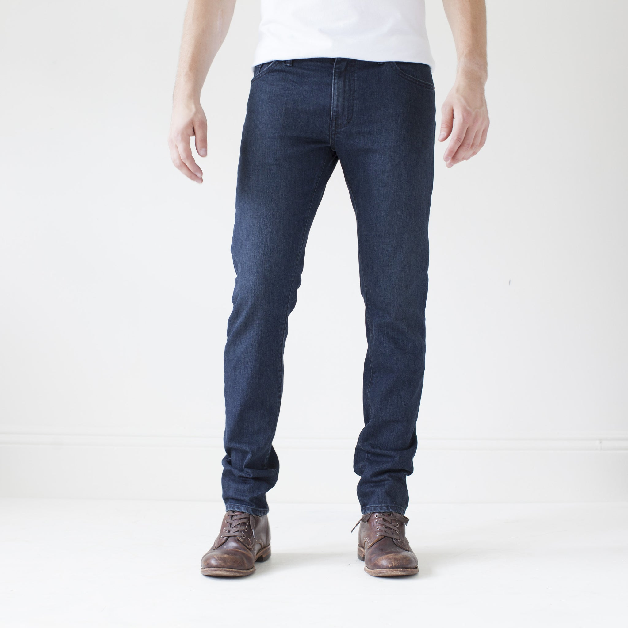 angle: canon  A model wears Raleigh Denim Workshop Martin thin taper fit jeans in original wash, front view