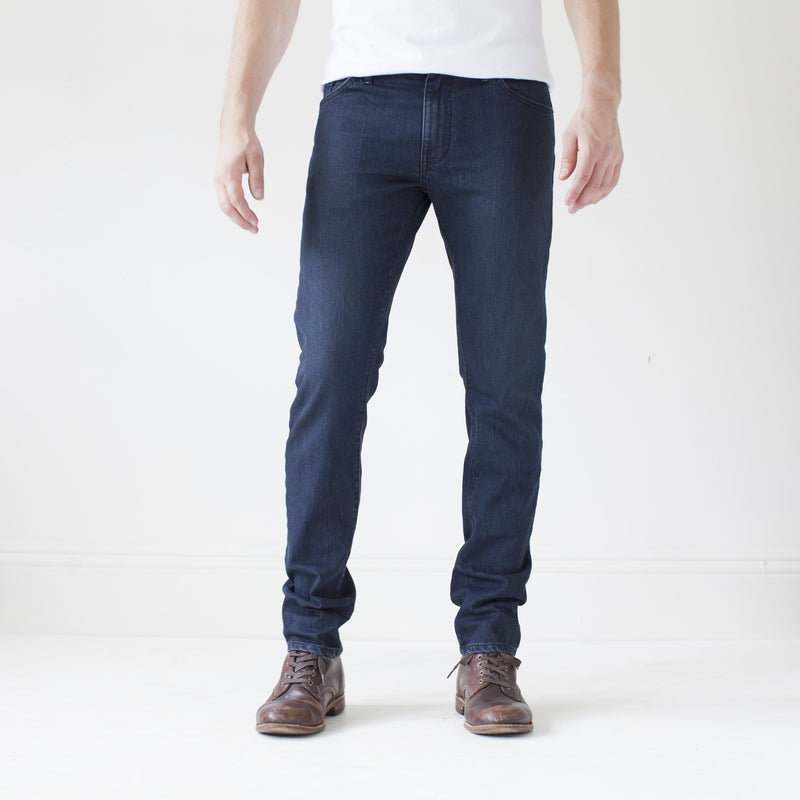 angle hover: canon  A model wears Raleigh Denim Workshop Martin thin taper fit jeans in original wash, front view