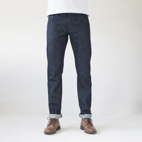 angle: static rinse | Raleigh Denim Workshop men's Jones thin fit selvage raw denim jeans in static dark rinse, front flat view