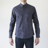 angle: floral print navy  Raleigh Denim Workshop Classic Button-up men's shirt in floral print navy, front on model.