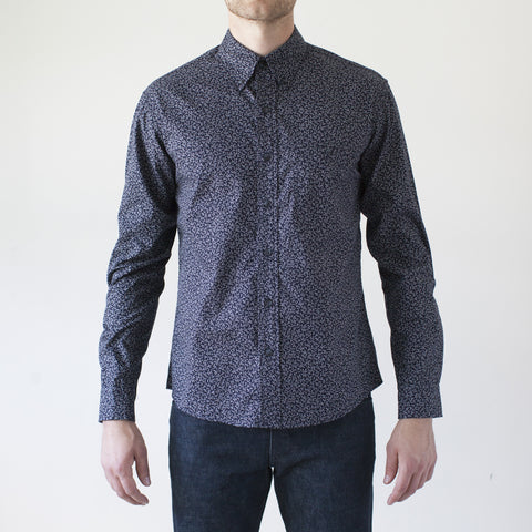 angle: floral print navy | Raleigh Denim Workshop Classic Button-up men's shirt in floral print navy, front on model.