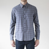 angle: blue check  Raleigh Denim Workshop Classic Button-up men's shirt in blue check, front on model.