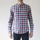 angle hover: jewel plaid   Raleigh Denim Workshop Classic Button-up Men's Shirt in red and blue jewel plaid, front on model.