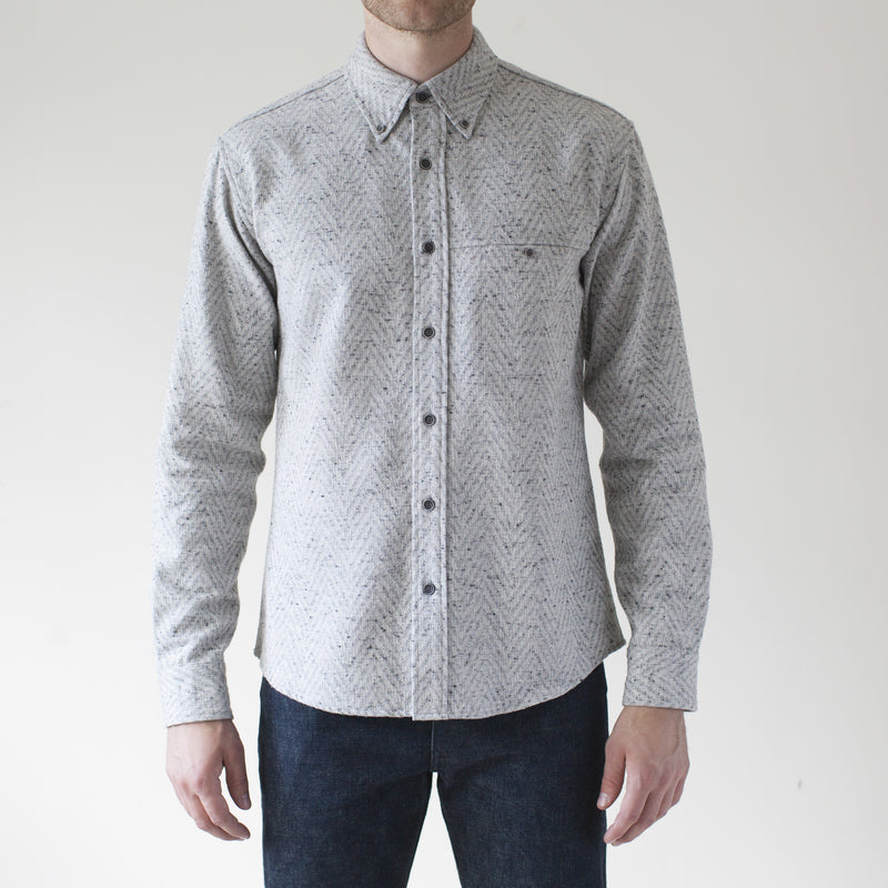 angle: grey heather  Raleigh Denim Workshop Classic Button-up: Slub in grey heather chevron pattern, front on model.