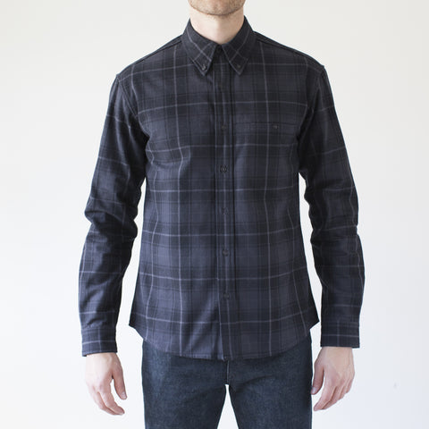 angle: charcoal plaid | Raleigh Denim Workshop Classic Button-up men's shirt in charcoal plaid, front on model 2.