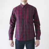 angle: hot pink check  Raleigh Denim Workshop Welt-Pocket Button-up men's shirt in red and hot pink check, front on model.