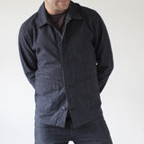 angle hover: charcoal  A model wears Raleigh Denim Workshop men's chore coat in grey, front view