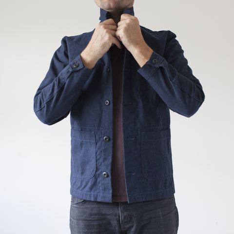 angle: navy | Raleigh Denim Workshop men's chore coat in navy blue, front flat view