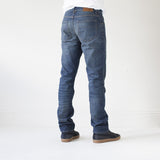 angle: camp  A model wears Raleigh Denim Workshop Jones thin fit, back view