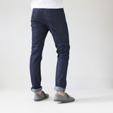 angle: resin rinse  A model wears Raleigh Denim Workshop Jones thin fit in a dark wash, back view