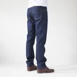 angle: resin rinse  A model wears Raleigh Denim Workshop Alexander work fit jeans with a dark wash, back view