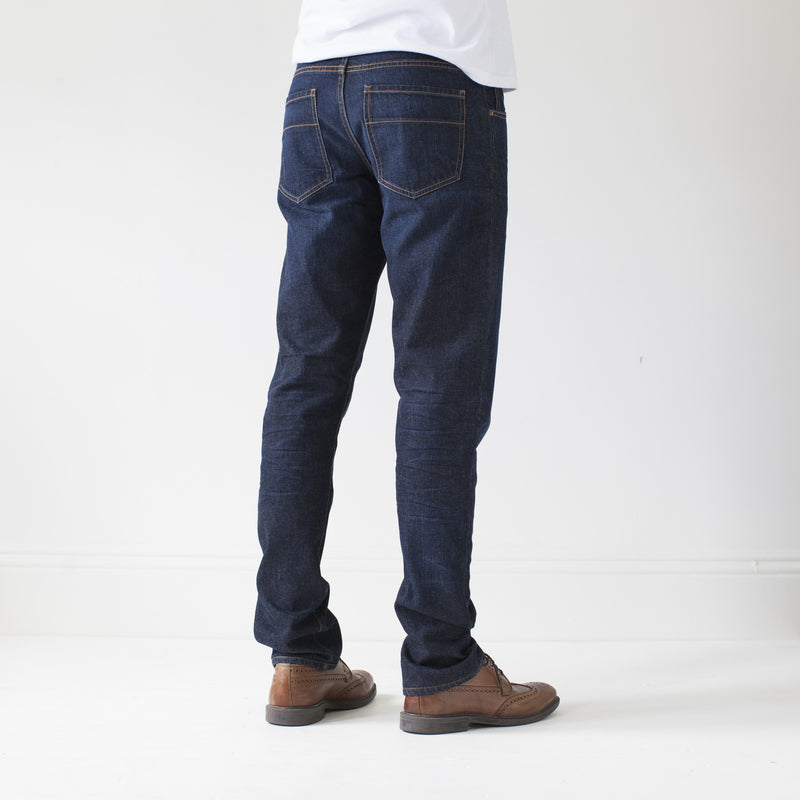 angle: general  A model wears Raleigh Denim Workshop Jones thin fit in a general wash, back view
