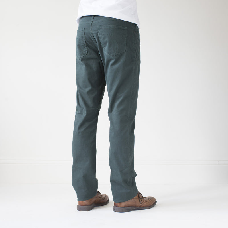 angle: juniper  Raleigh Denim Workshop Jones thin fit brushed twill pants, in juniper green blue, rear side view