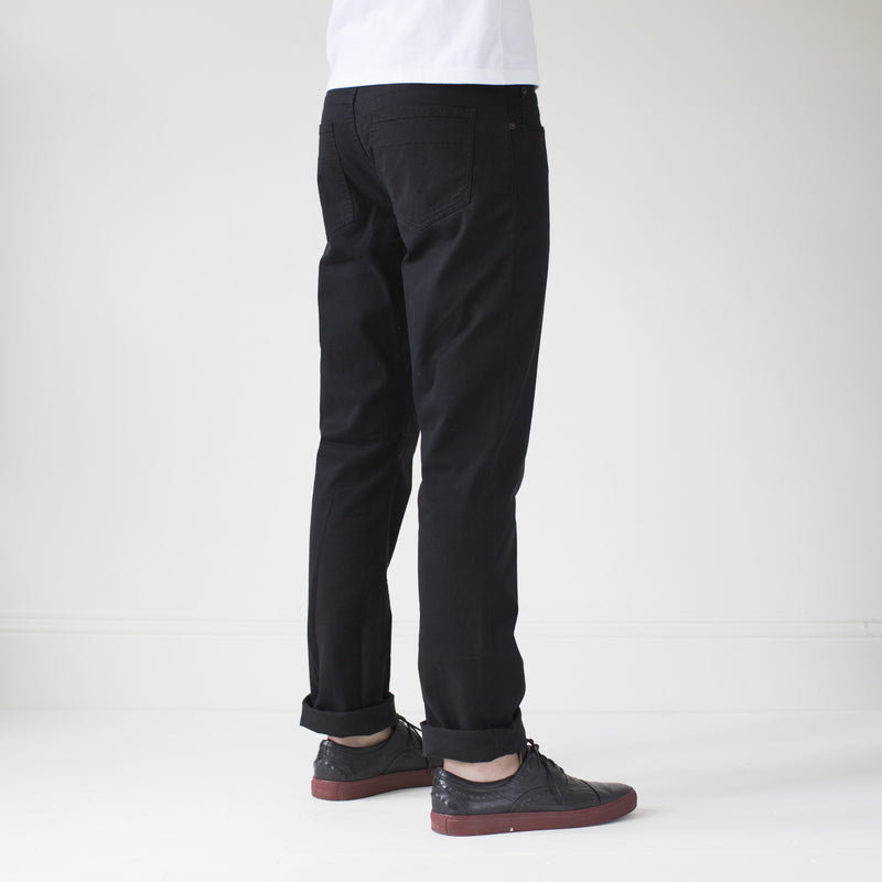 angle: black  Raleigh Denim Workshop Jones thin fit brushed twill pants, in black, rear side view