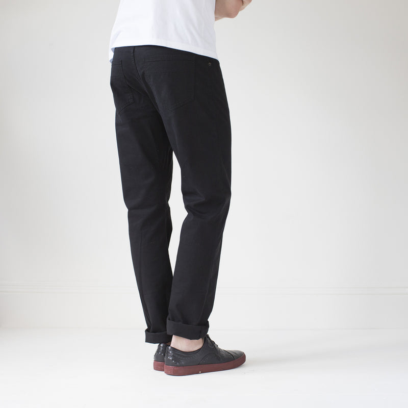 angle: black  Raleigh Denim Workshop Jones thin fit brushed twill pants, in black, rear side view 2