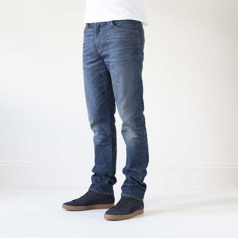 angle hover: camp  A model wears Raleigh Denim Workshop Jones thin fit, front view