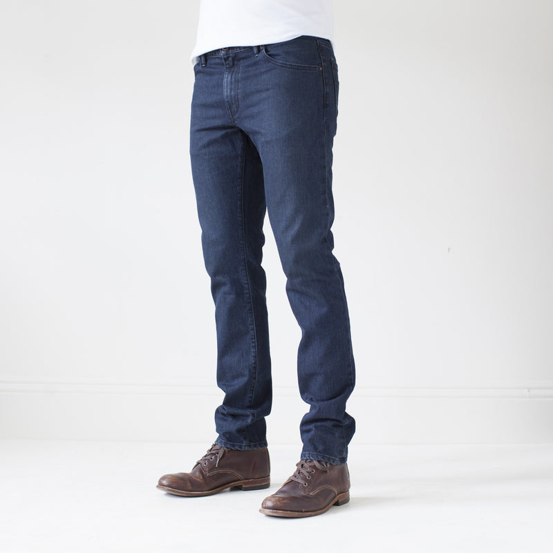 angle: canon  A model wears Raleigh Denim Workshop Martin thin taper fit jeans in original wash, side view