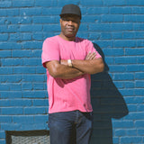 angle: red  Rosando wears Raleigh Denim Workshop cotton pocket crew neck tee in red, front view