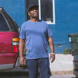 angle: navy  Rosando wears Raleigh Denim Workshop cotton pocket crew neck tee in navy, front view