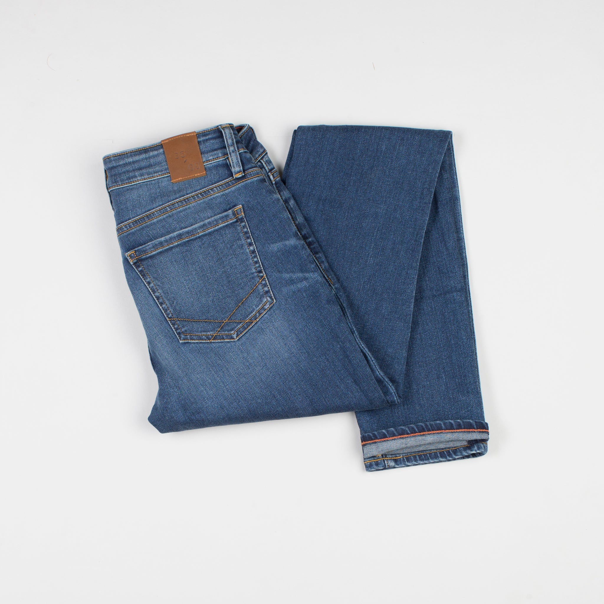 angle: perfecto  Raleigh Denim Workshop Surry mid-rise thin fit jeans in a classic wash, back view