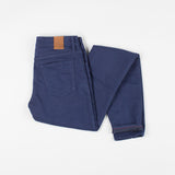 angle: navy  Raleigh Denim Workshop Surry mid-rise thin fit jeans in dark navy, back view