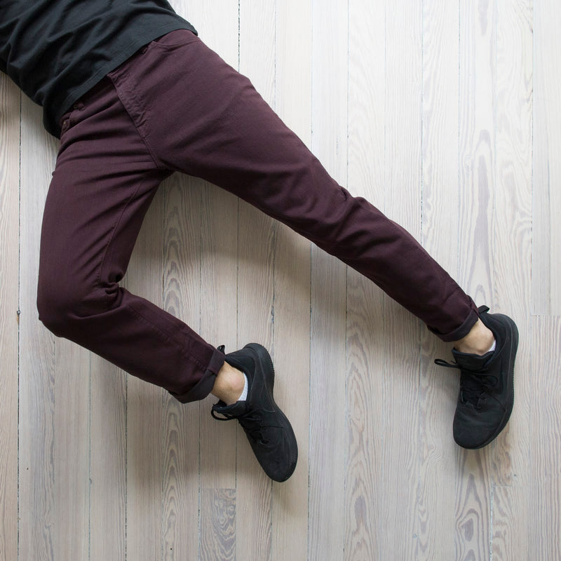 angle hover: currant Raleigh Denim Workshop model alexander stretch pants currant