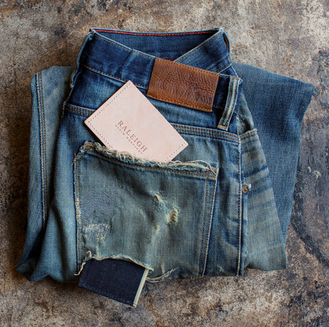 angle: denim + leather | Raleigh Denim Workshop denim and leather card holder wallet, made with our Original Selvage denim, front with leather stamp.