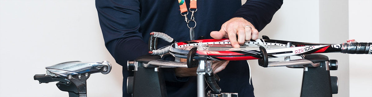 Man stringing tennis racquet