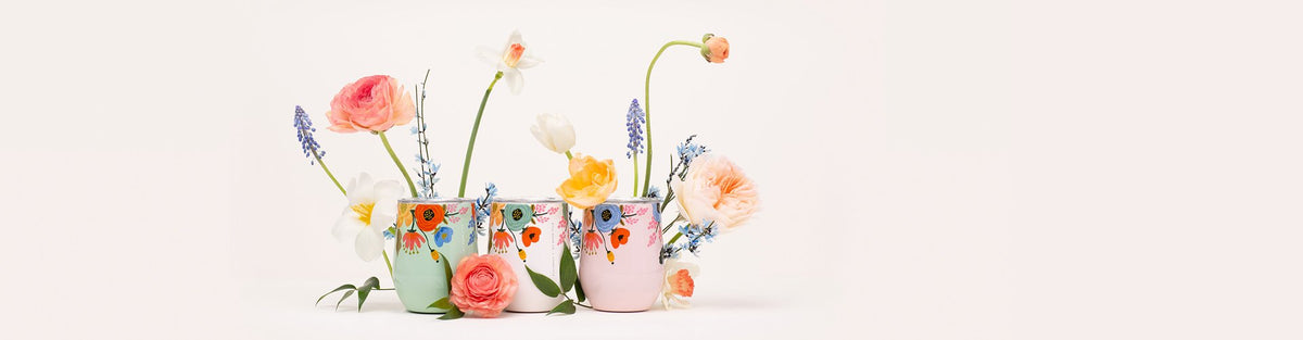 Spring flowers in pastel plant pots