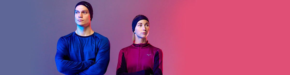 Man and woman running in Mizuno running gear