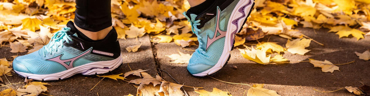 6aa10b597a19 Woman wearing blue Mizuno Wave Inspire 15 running shoes in the fall