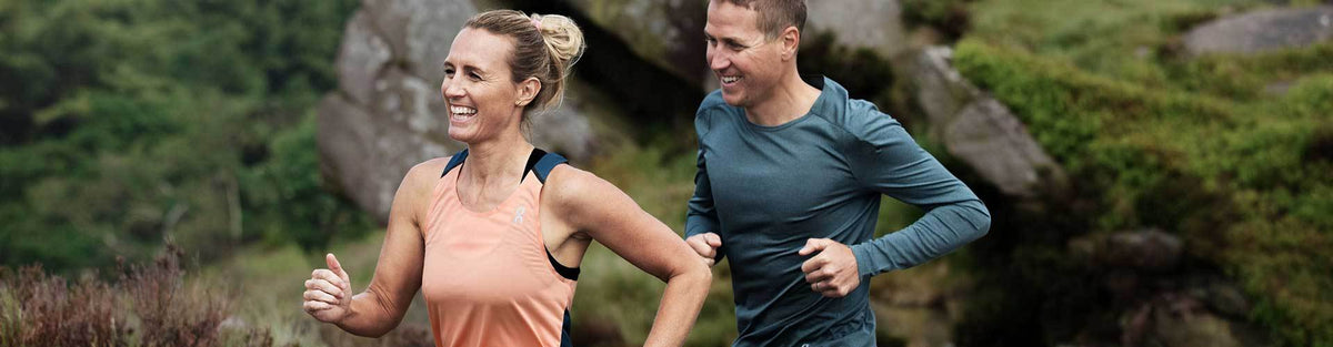 Man and woman in On Running High Arch Running Shoes outdoors