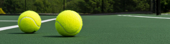 Tennis balls on tennis court