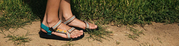 Woman wearing Teva sandals by the beach