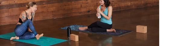 Women with Manduka Yoga Mats