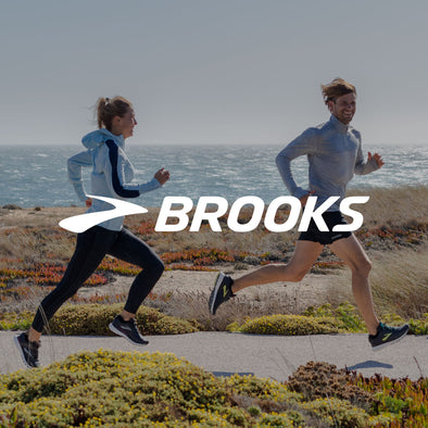 Man and Woman Running in Brooks Running Gear with Logo