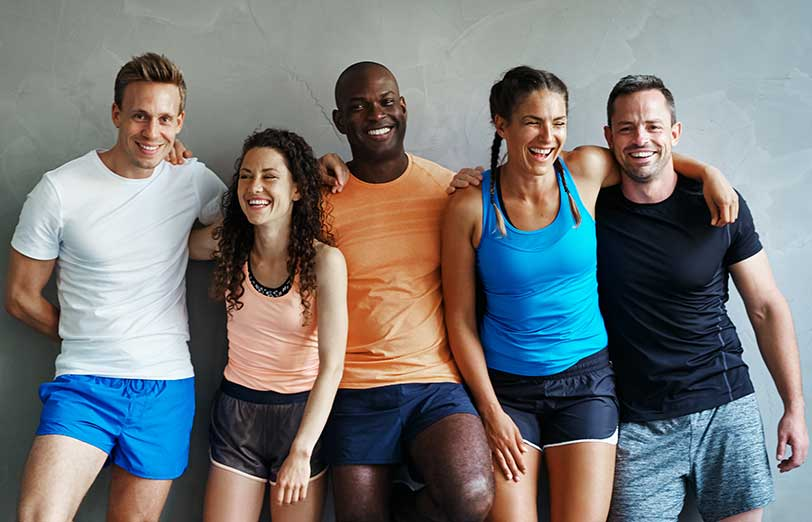 Group of happy fitness people