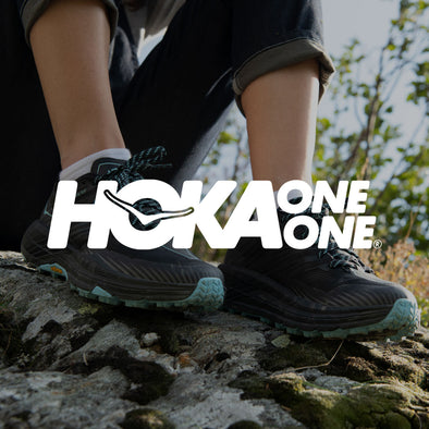 Woman in Hoka One One Trail Running Shoes with Logo