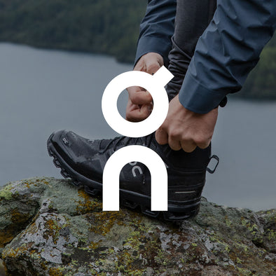 Man in On Trail Running Shoes with Logo