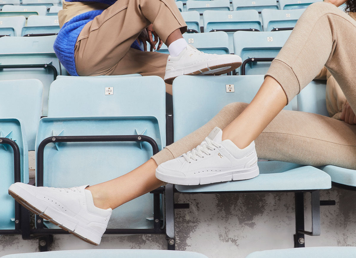 Closeup of woman and man in bleachers weraing On The Roger Centre Court tennis shoes