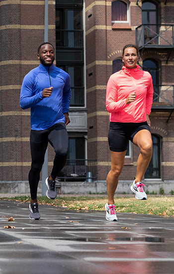 Man and woman running in Brooks running clothing and shoes