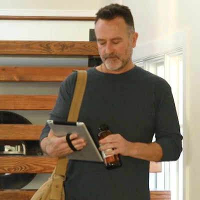 Man holding tablet using LoveHandle XL Tablet Grip.