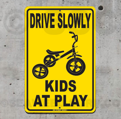 AA472 Drive Slowly Kids At Play - Tricycle - Seaweed Surf Sign Co