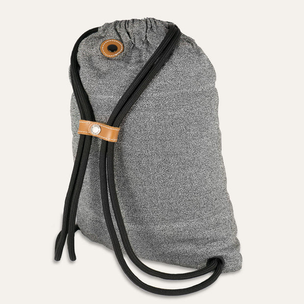 The Flak Sack by the Loctote Industrial Bag Co theft resistant drawstring backpack.