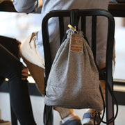 Lock your bag to any fixed chair or object with the Flak Sack anti-theft bag.